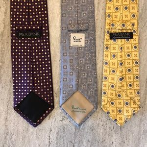 Bundle of three ties - purple, blue, and yellow